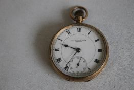 A 9ct GOLD OPEN FACE TOP WIND POCKET WATCH, white enamel dial signed 'Thos Russell and Son