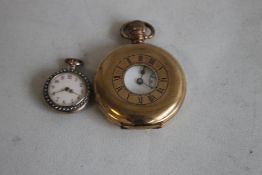 A CONTINENTAL GILT METAL ENAMELLED LADIES FOB WATCH, with pearl set bezel and borders along with a