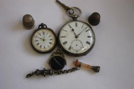 A LATE 19TH CENTURY OPEN FACE KEY WIND POCKET WATCH, with a ladies fob watch, two thimbles and two