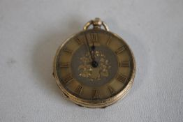 A YELLOW METAL (MARKED 14ct) OPEN FACE FOB WATCH, gilt engraved dial with applied markings.