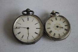 TWO LATE 19TH CENTURY WHITE METAL CASED FOB WATCHES, both with engraved cases.