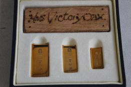 ROYAL MINT HMS VICTORY/ GOLD INGOT SET. consisting of a piece of Victory wood and 3 graduation 9ct