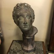 A LATE 19TH / EARLY 20TH CENTURY PATINATED PLASTER LIBRARY BUST (AFTER AN ANTIQUE CLASSICAL MARBLE