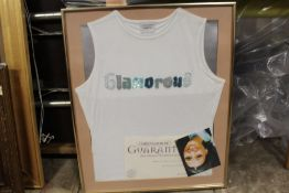 A FRAMED AND GLAZED VEST TOP WORN BY SURANNE JONES FROM CORONATION STREET (KAREN MCDONALD) WITH