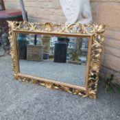 A LARGE ORNATE 19TH CENTURY ITALIAN FLORENTINE CARVED WOOD FRAME WITH FITTED MIRROR