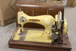 A CASED VINTAGE BSM SEWING MACHINE