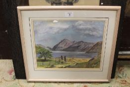 A FRAMED AND GLAZED WATERCOLOUR OF A MOUNTAINOUS LAKE SCENE SIGNED MURIEL DEXTER