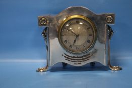 AN ANTIQUE EPNS CASED EIGHT-DAY MANTEL CLOCK
