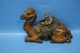 AN ANTIQUE COLD PAINTED INKWELL IN THE FORM OF A CAMEL WITH SADDLE