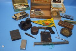 A BOX OF COLLECTABLES TO INCLUDE AN EARLY MARMITE TIN, BAKELITE VIDEOMASTER, CHANEL NO. 5 BOX,