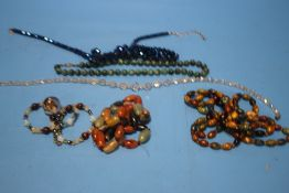 A COLLECTION OF GLASS AND HARDSTONE NECKLACES ETC.