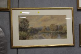 A GILT FRAMED AND GLAZED WATERCOLOUR DEPICTING A COUNTRY RIVER SCENE WITH CATTLE GRAZING