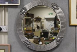 A MODERN SILVER FRAMED CIRCULAR BEVEL EDGED WALL MIRROR