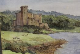 A FRAMED AND GLAZED WATERCOLOUR DEPICTING DUNVEGAN CASTLE, ISLE OF SKYE WITH SHEEP GRAZING IN THE