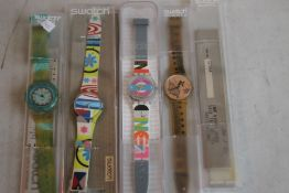 FOUR VINTAGE SWATCH WATCHES, together with various Swatch boxes
