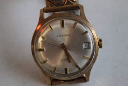 """A GENTLEMANS 9 CT GOLD """"'EXCALIBUR""""' WRISTWATCH, on a plated strap"""