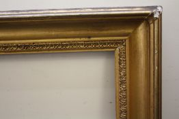 AN 18TH CENTURY GOLD FRAME WITH DECORATIVE DESIGN TO INNER EDGE, frame W 9 cm, frame rebate 77 x