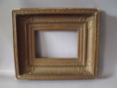A 19TH CENTURY GOLD FRAME WITH INTEGRAL SLIP, frame W 12 cm, frame rebate 17 x 24 cm