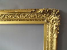 A 19TH CENTURY DECORATIVE GOLD FRAME WITH CORNER EMBELLISHMENTS, frame W 9 cm, frame rebate 72 x