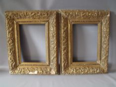 A PAIR OF LATE 18TH / EARLY 19TH CENTURY DECORATIVE GOLD FRAMES A/F, decorated with various