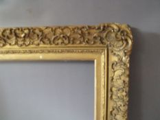 A 19TH CENTURY DECORATIVE GOLD FRAME WITH GOLD SLIP, frame W 5 cm, frame rebate 61 x 45 cm, slip