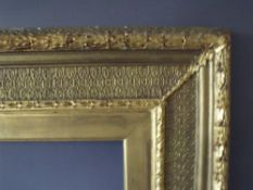 A 19TH CENTURY DECORATIVE GOLD FRAME WITH GOLD SLIP, frame W 12 cm, frame rebate 69 x 59 cm, slip