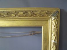 A 19TH CENTURY GILT FRAME WITH ACANTHUS LEAF DESIGN TO EDGE AND GOLD SLIP, frame W 7 cm, frame