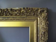 A 19TH CENTURY DECORATIVE GOLD FRAME WITH GOLD SLIP A/F, frame W 10 cm, frame rebate 58 x 43 cm,