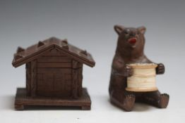 A BLACK FOREST BEAR COTTON REEL HOLDER, together with a chalet inkwell, W 9 cm (2)
