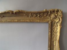 A LATE 19TH CENTURY / EARLY 20TH CENTURY GOLD SWEPT FRAME, frame W 7 cm, frame rebate 92 x 61 cm