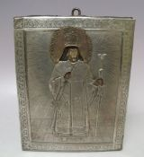(XIX). A religious icon on panel with exposed head and hands and white metal oklad with acrylic