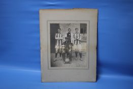 W.U.F.C. 1911-12, a photograph of four men with two trophies and a football, two in sports strip and