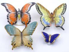 Vier unterschiedlich große Schmetterlinge versch.Marken,L-3,7-9,5c