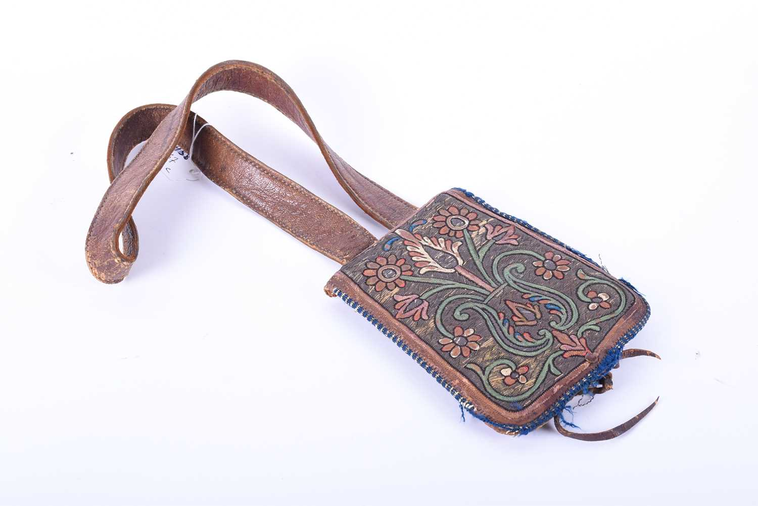 Lot 317 - A Persian leather shoulder bag/purse, with coloured thread floral decoration against a gilt thread
