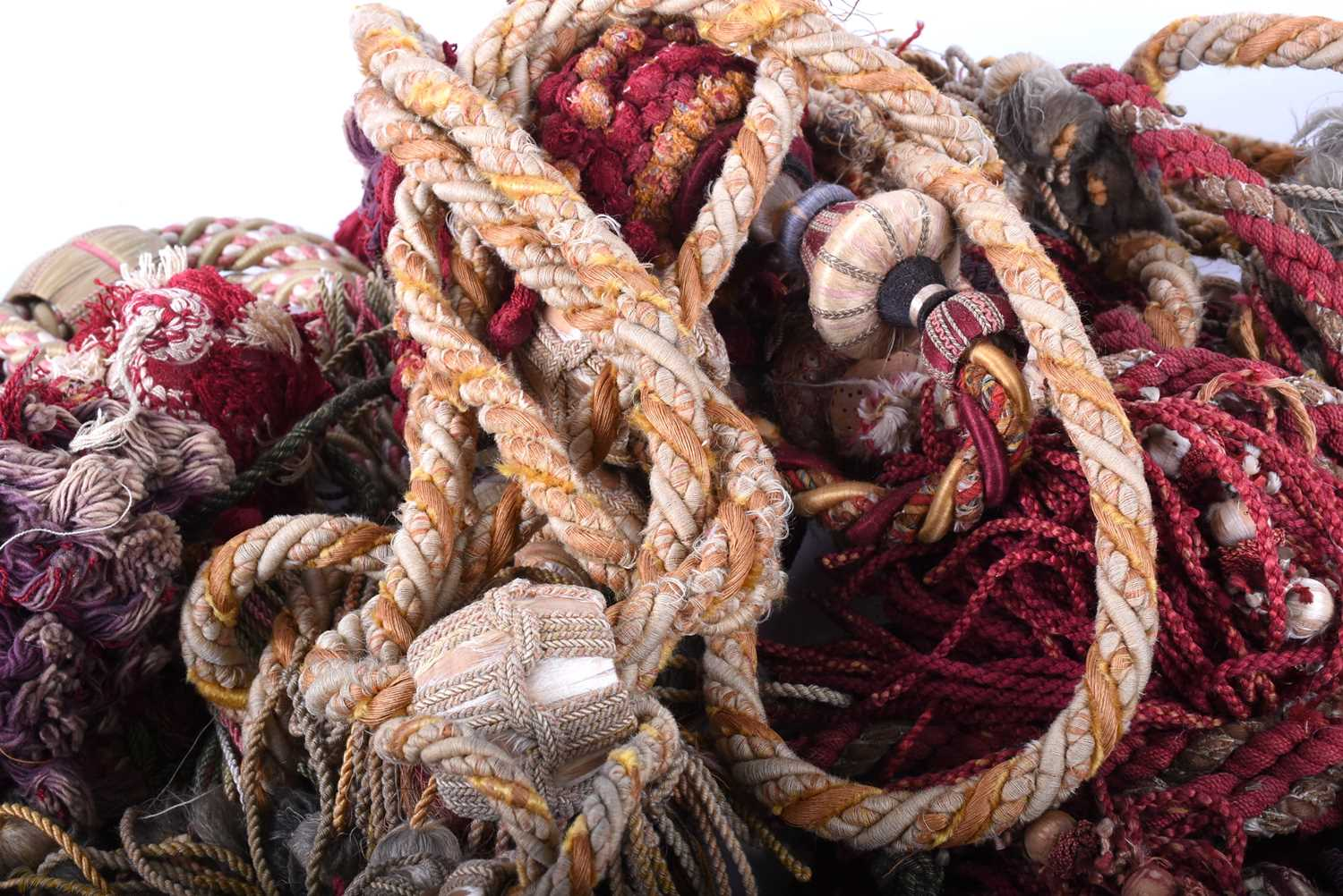 Lot 306 - A small collection of antique passementerie, 19th century, some with silk thread knops, comprising