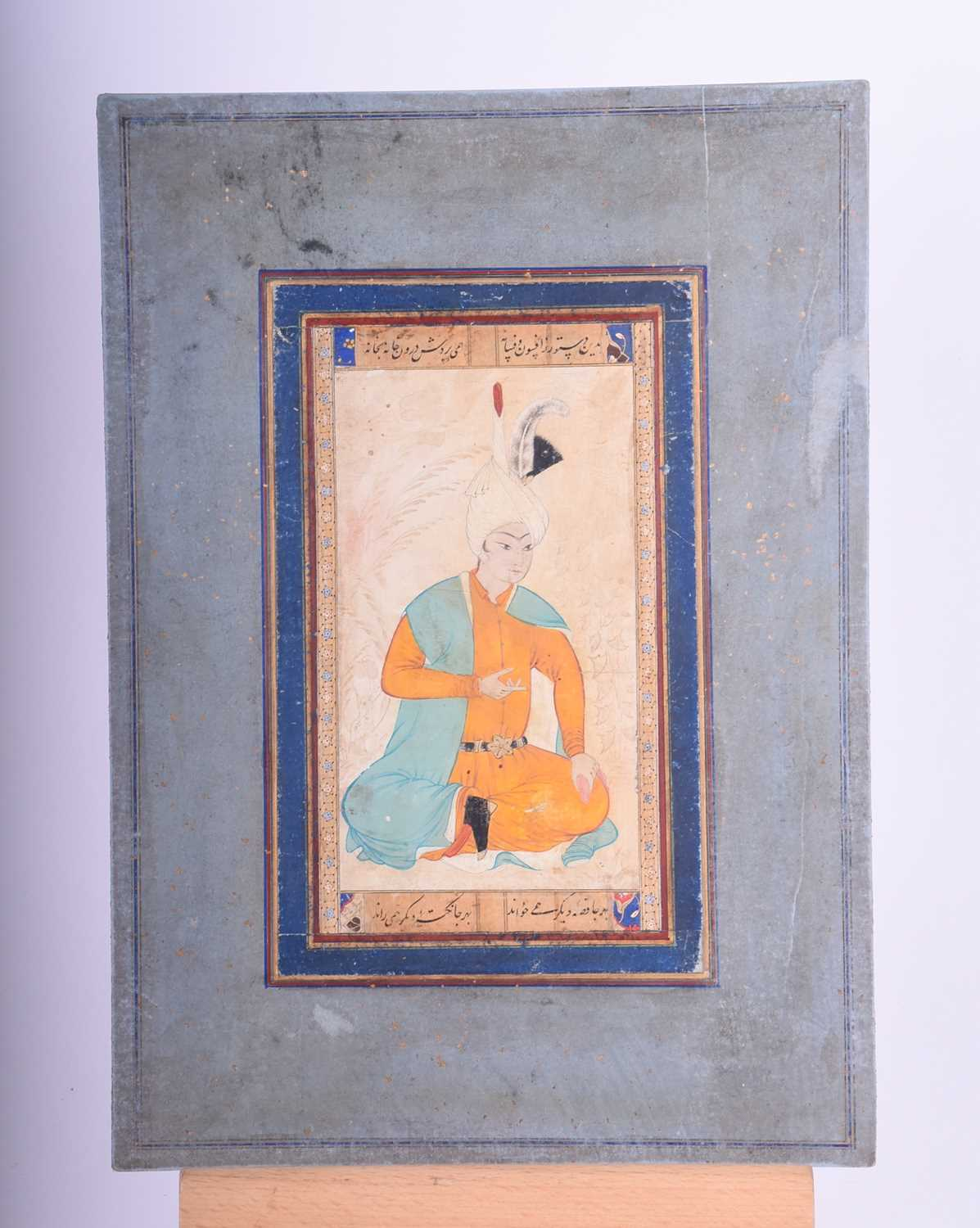 Lot 194 - 19th century Indian school, A seated nobleman, surrounded by foliage, between panels of script and