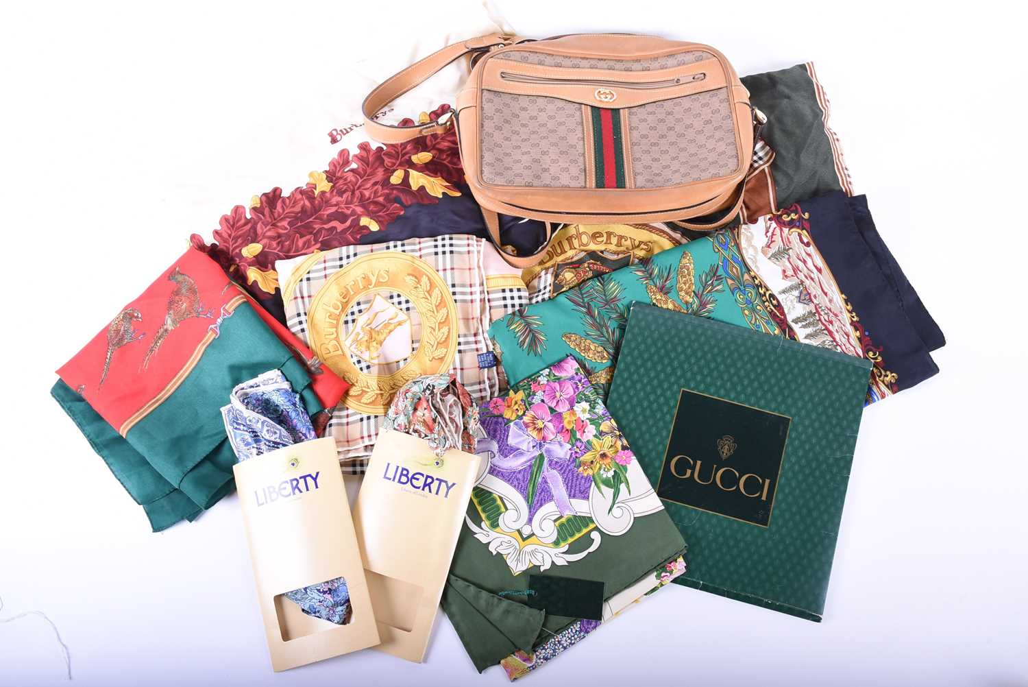Lot 335 - A ladies Gucci shoulder bag, together with a collection of silk scarves, 2 x Gucci, 2 x Liberty, 3 x