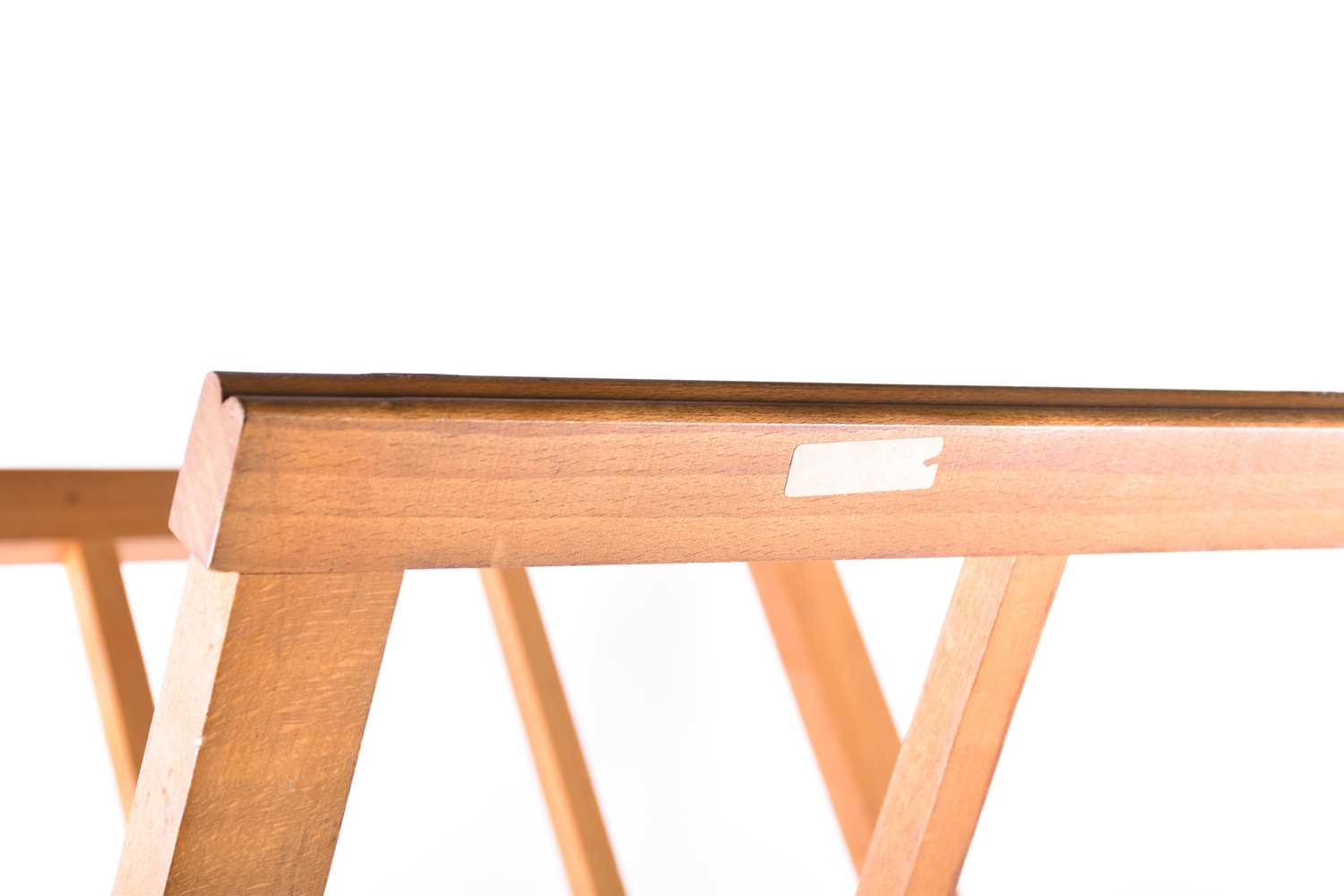 Lot 57 - A mid-20th-century wooden folio browser stand of X frame shape, bearing the address label of 'Franco