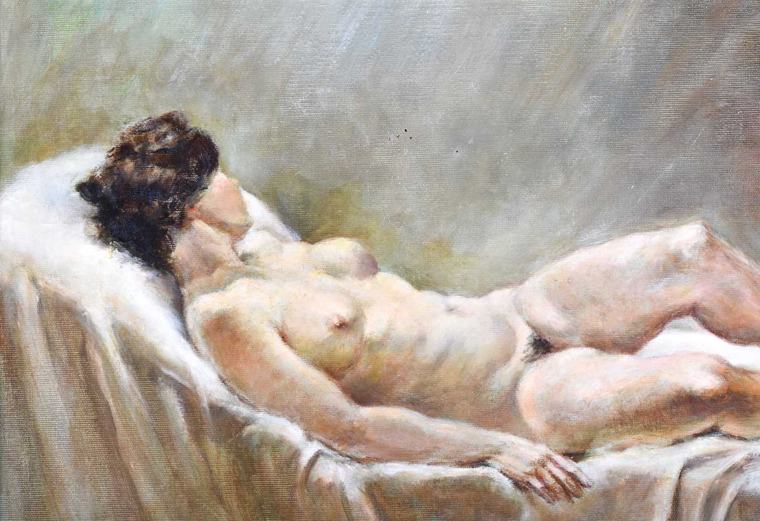 Lot 4 - Franco Matania (1922-2006) Italian/British,a painting of a recumbent female nude on a bed, signed F.