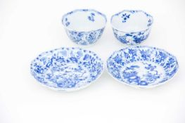 A near pair of Chinese blue & white petal moulded tea bowls and matched saucers, Kangxi (1662 -