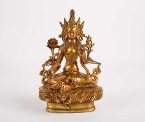A Tibetan gilt bronze figure of Tara, 中国,藏铜鎏金多罗菩萨像一尊 seated flanked by flowers and ribbons, on a