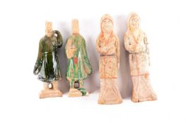 Two pairs of Chinese pottery tomb figures, Tang dynasty, 中国,墓俑两对,唐代 comprising two porters with