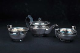 A George V three-piece silver teaset, Sheffield 1924 by James Dixon & Sons, comprising a teapot,