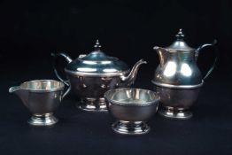 A George V silver four-piece tea set, Birmingham 1931 by Dennison, comprising a teapot, hot water
