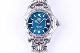 A Tag Heuer Professional quartz wristwatch, the metallic dial with luminous baton indices and date