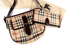A Burberry handbag, in the Haymarket plaid pattern, approximately 25 cm wide, with long brown