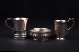 A George V silver christening tankard, London 1923 (maker indistinct), of bellied form with scroll