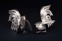 A pair of silver fighting cocks, realistically modelled, stamped '925' and bearing import marks