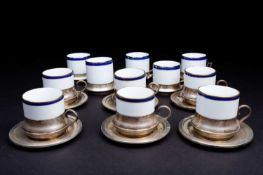 Eleven Italian porcelain and silver mounted coffee cans, together with six conforming silver