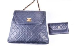 Chanel. A classic quilted leather handbag, of tapered square design, with gold tone CC logo clasp,